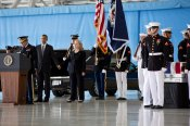 a-poignant-photo-of-obama-and-secretary-of-state-hillary-clinton-during-the-memorial-of-the-four-killed-in-the-benghazi-attack